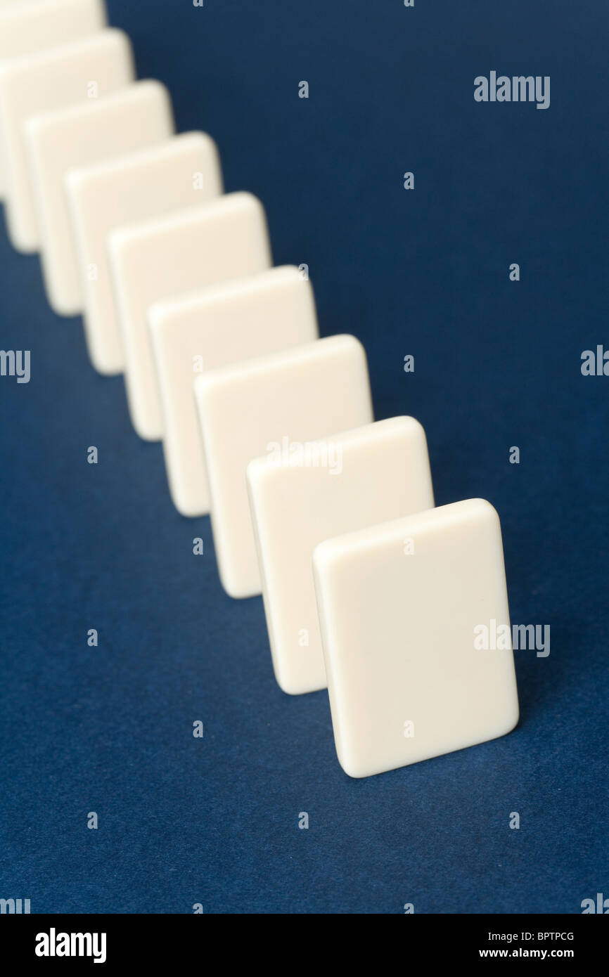 Domino with blue background, Concept of Cause or Teamwork - Stock Image