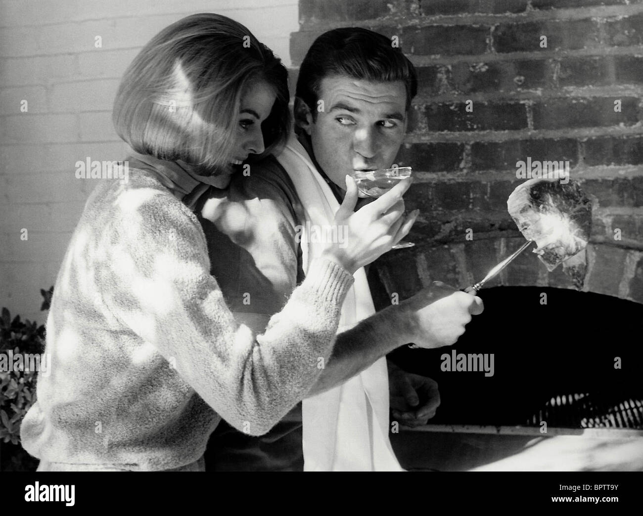 ROD TAYLOR & WOMAN ACTOR (1960) - Stock Image