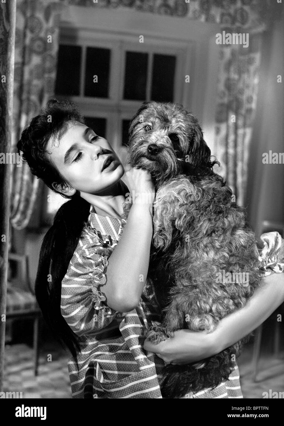 CORNY COLLINS WITH DOG ACTRESS (1957) - Stock Image