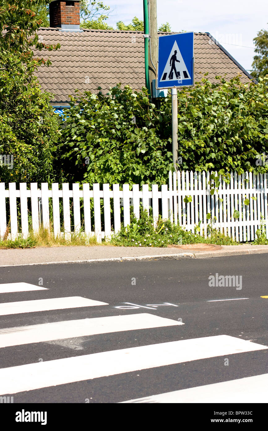 A road sign and zebra crossing in Asgardstrand, Norway. Stock Photo