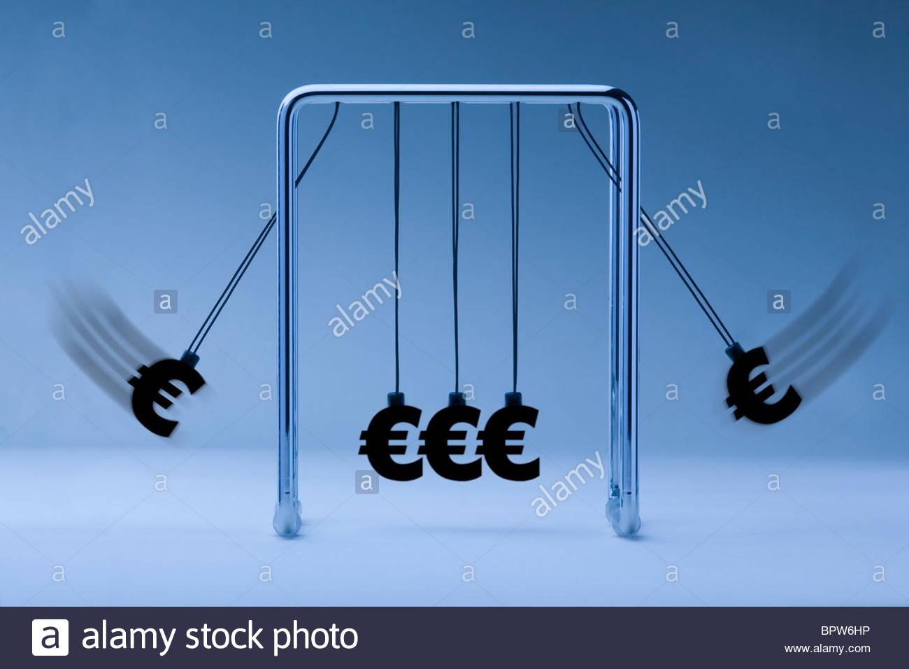 Newtons cradle with euro symbols on blue background Stock Photo