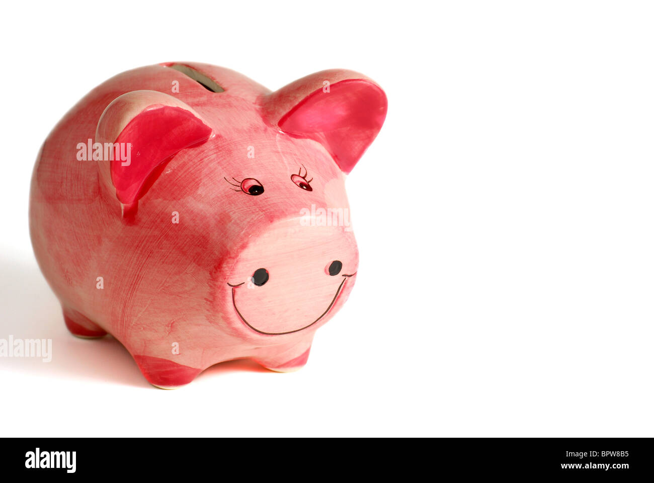 Pink piggy bank on white background - Stock Image