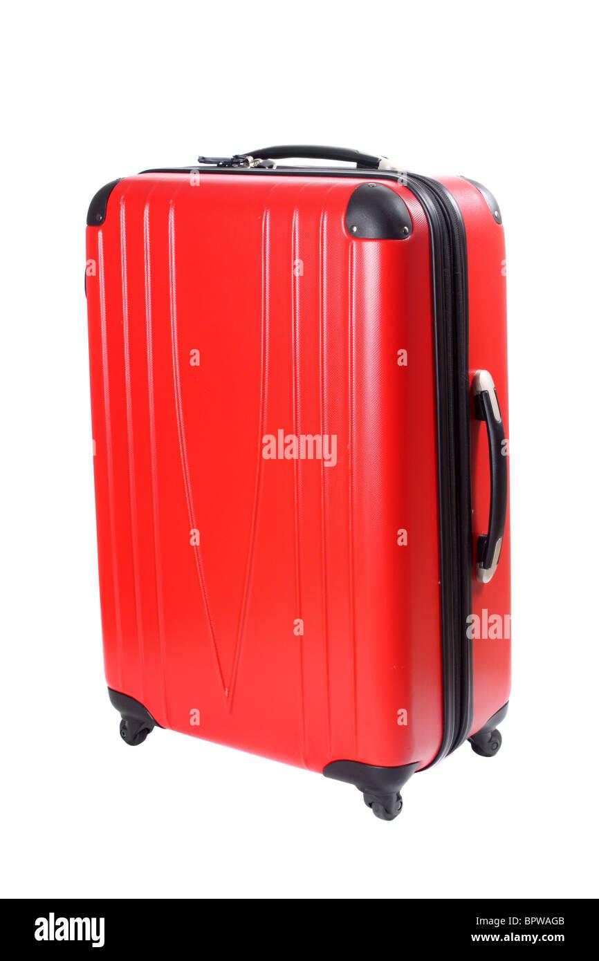 Four wheeled hard shell red suitcase - Stock Image