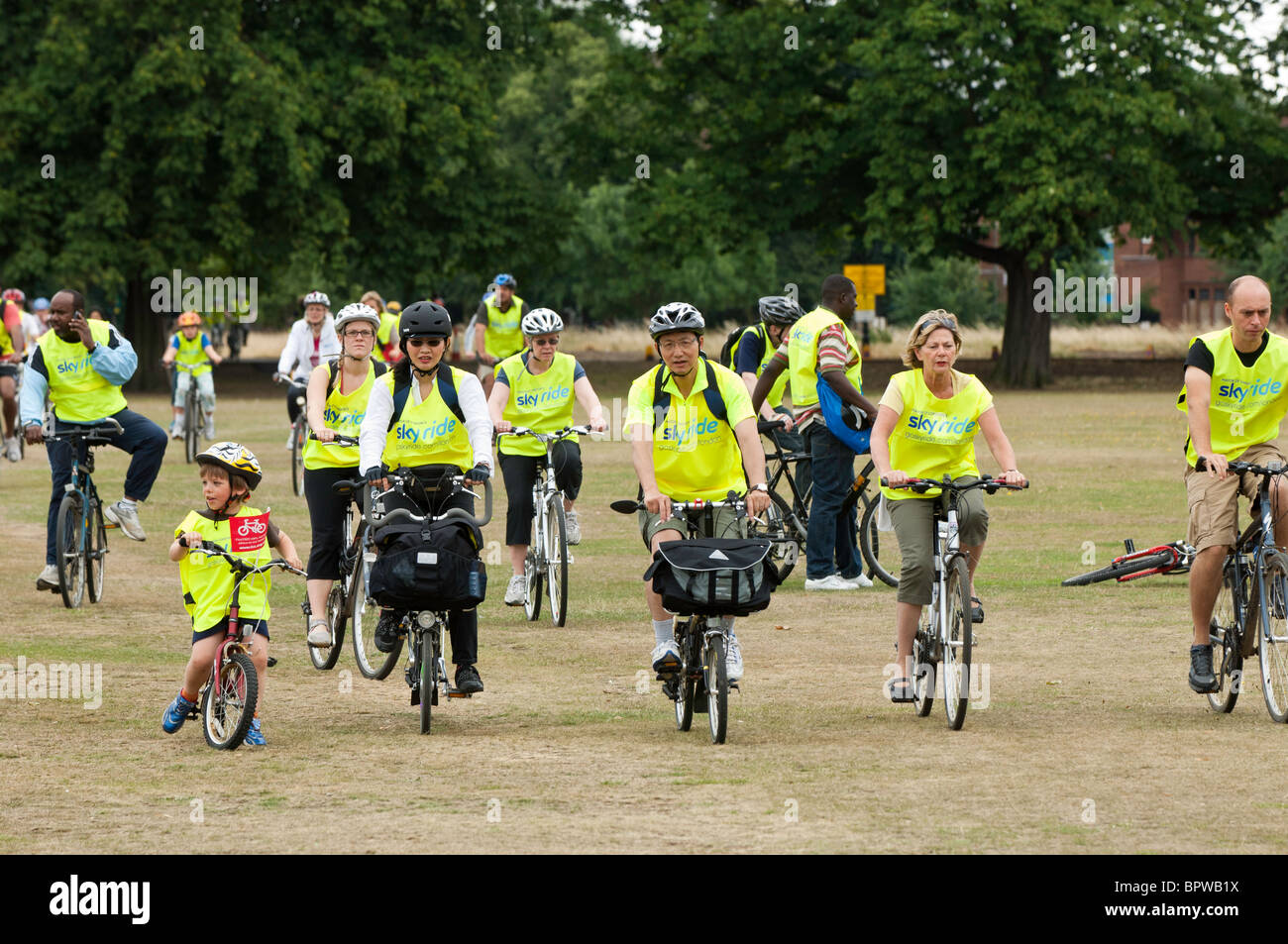 People cycle across Ealing Common during Mayor of London's Sky Ride Ealing 2010 event, United Kingdom - Stock Image