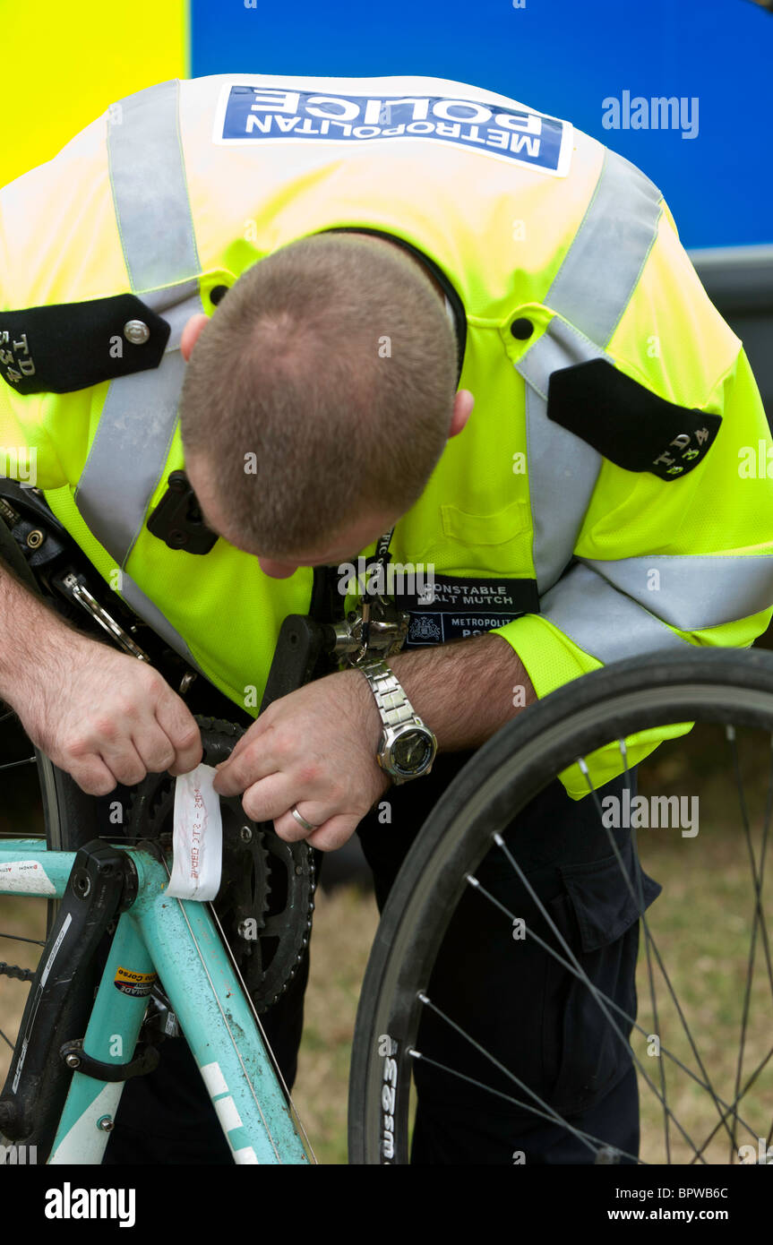 Police officers are security tagging bicycles as antitheft measure during Mayor of London's Sky Ride Ealing - Stock Image