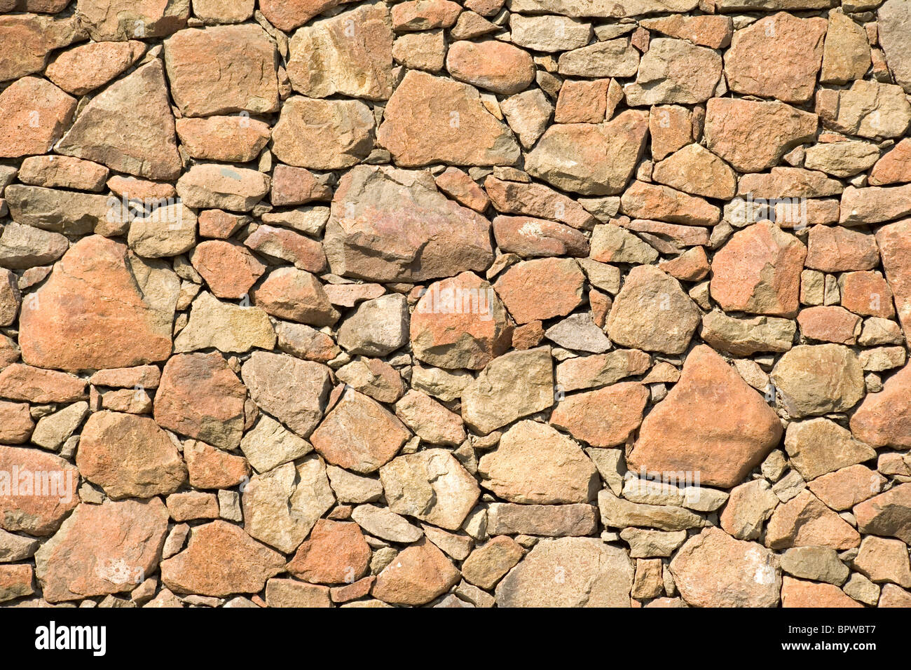 Yellow rock wall pattern for background - Stock Image