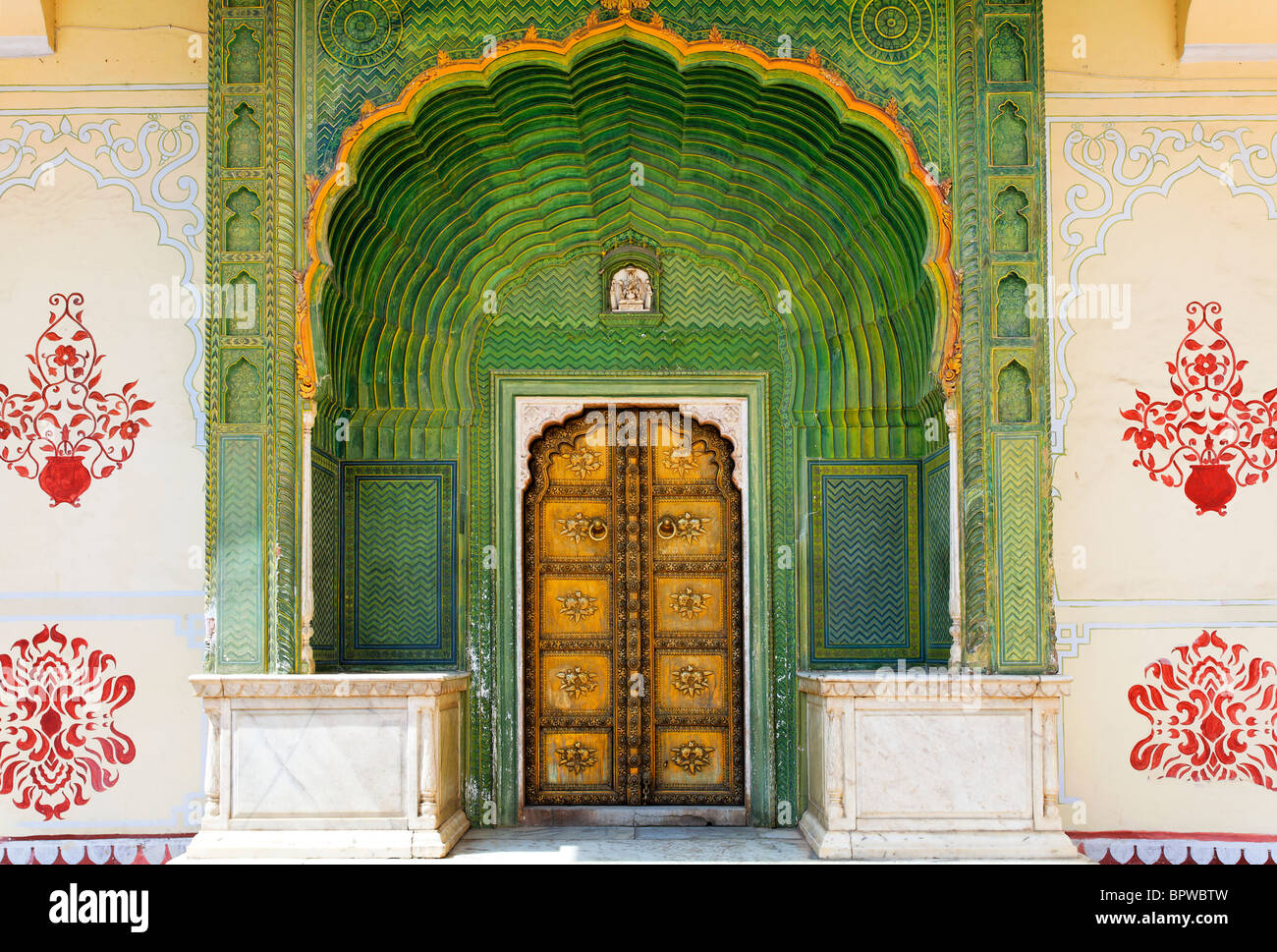 Ornate doorway in the Peacock Courtyard inside the City Palace complex, Jaipur, Rajasthan, India - Stock Image