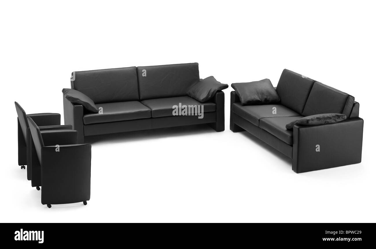 A view of a black leathered sofa - Stock Image