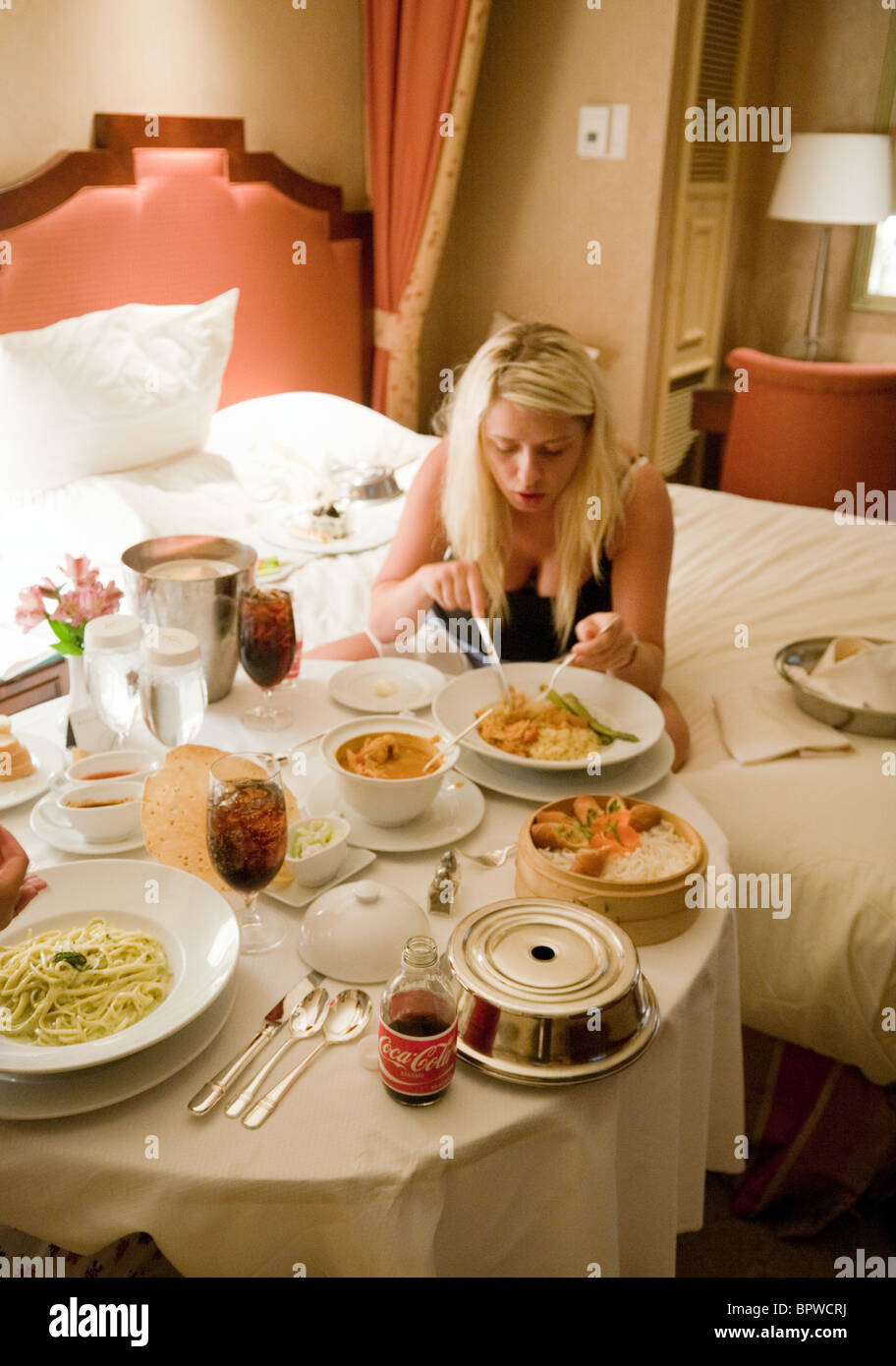 Room Service: Teenage Girls Enjoying A Meal In Their Hotel Room From