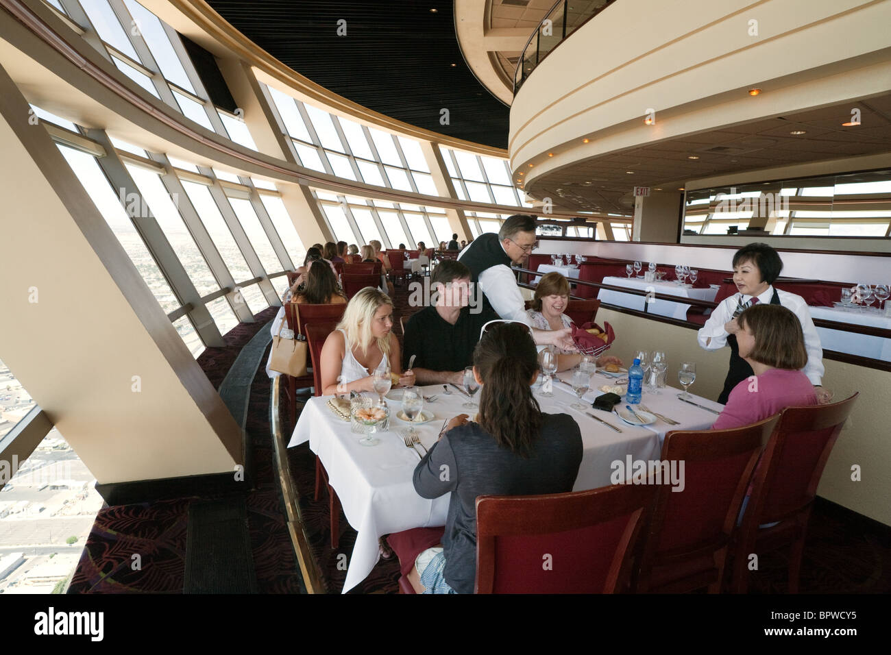 A Family Eating In The Top Of The World Revolving