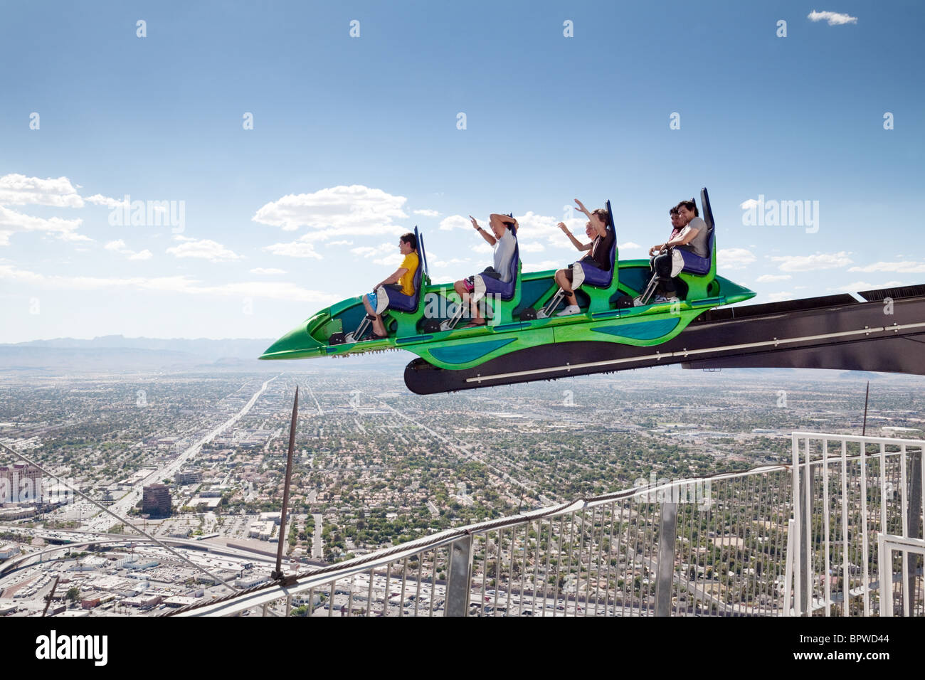people enjoying the X-scream ride at the top of the Stratosphere hotel, Las Vegas - Stock Image
