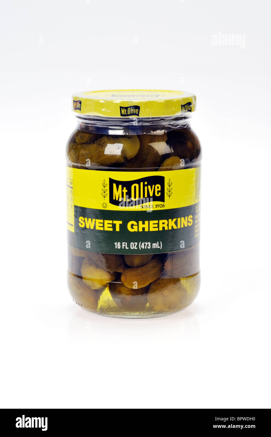 Jar of sweet gherkin pickles by Mt. Olive Pickle Company on white background, cutout. - Stock Image