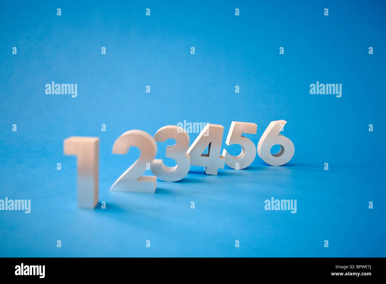 Sequence of numbers 1, 2, 3, 4, 5, 6, on blue background - Stock Image