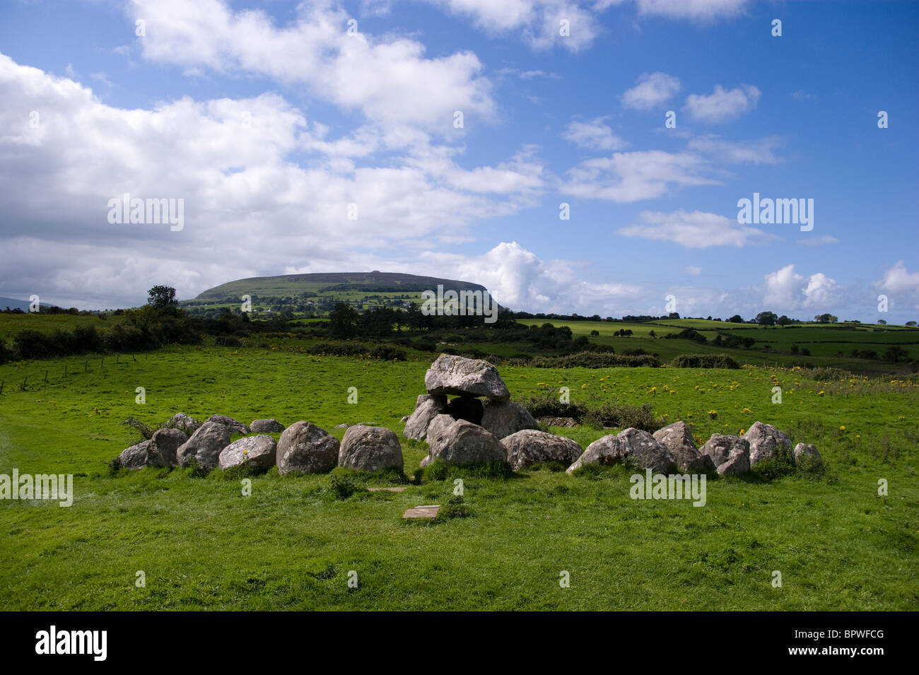 Stone Circle and Domen in Carrowmore Megalithic Cemetery with Knocknarea mountain and queen maeve's cairn behind - Stock Image