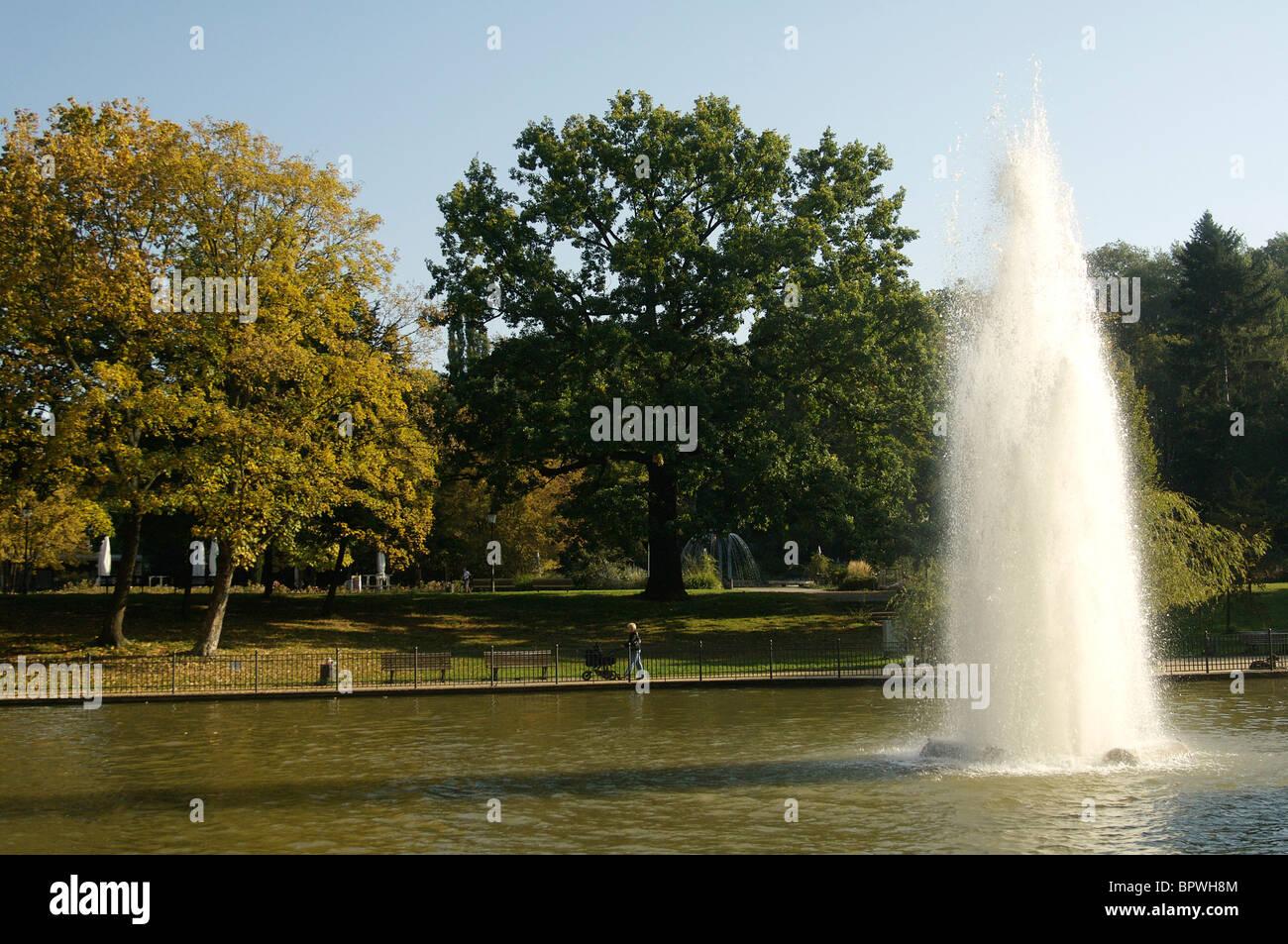 Fountain in the lake at Volkspark Friedrichshain park in Berlin - Stock Image