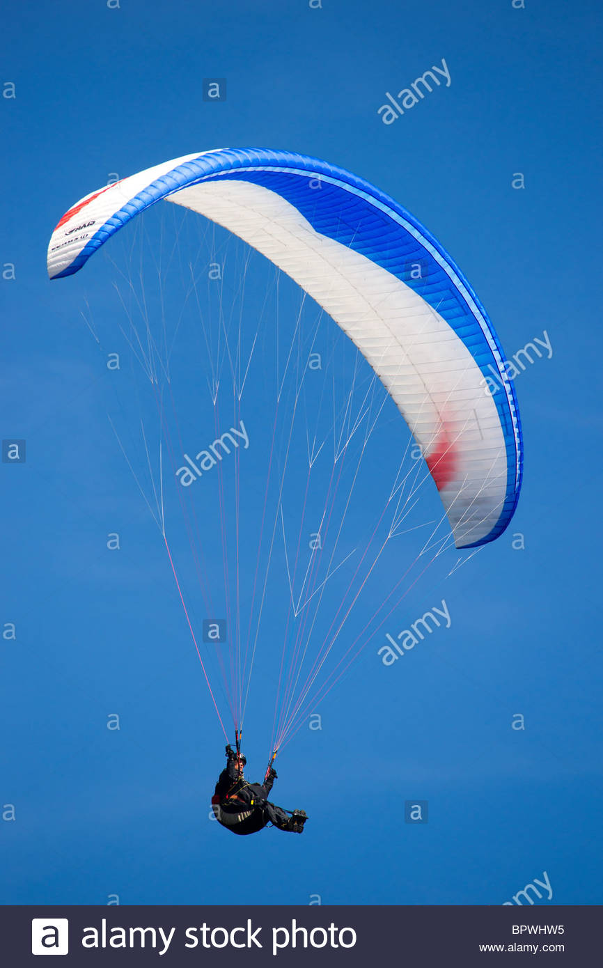 Paraglider against blue sky Stock Photo