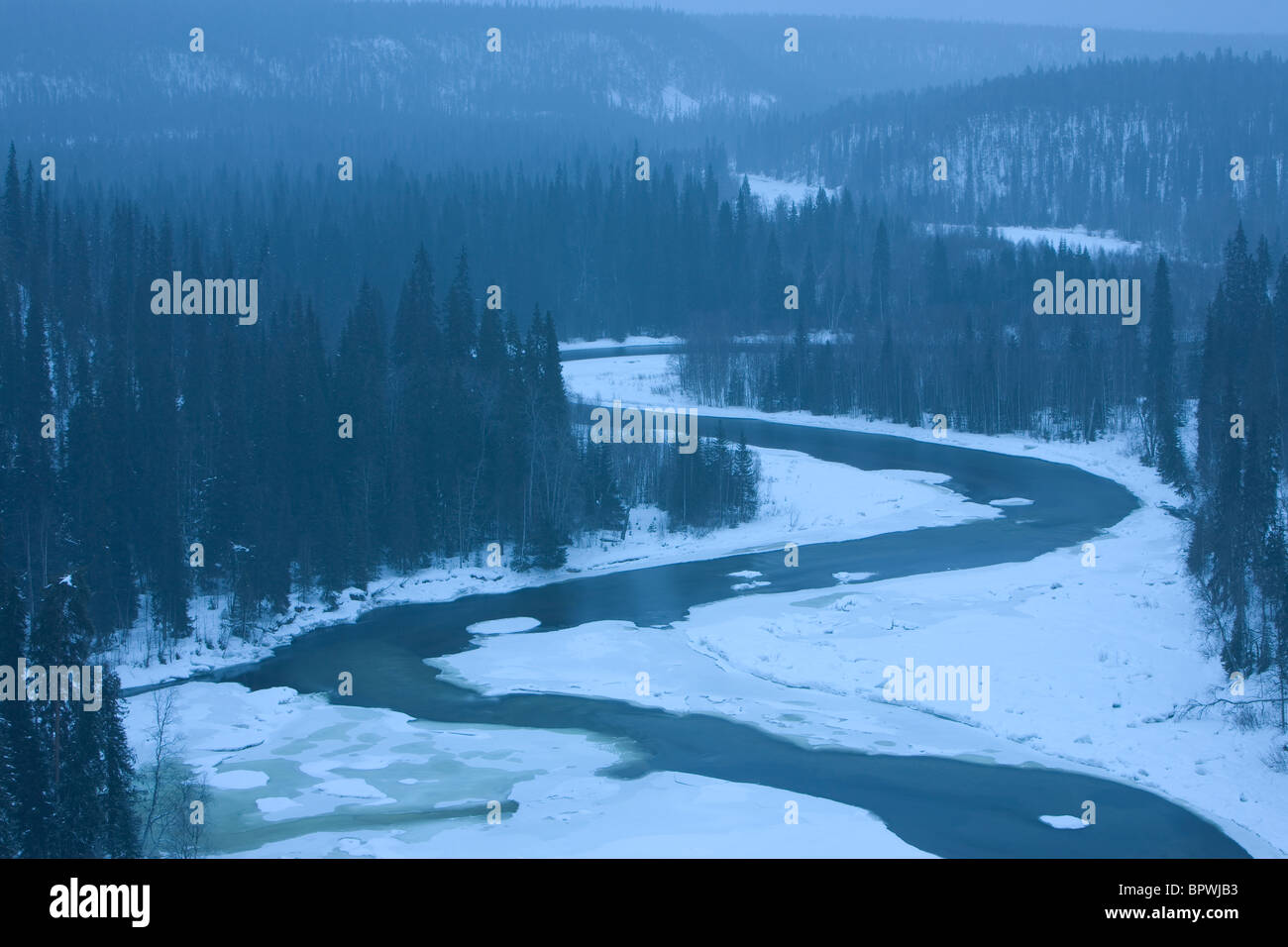 The Kitka River in a snowstorm in Oulanka National Park, Finland. - Stock Image