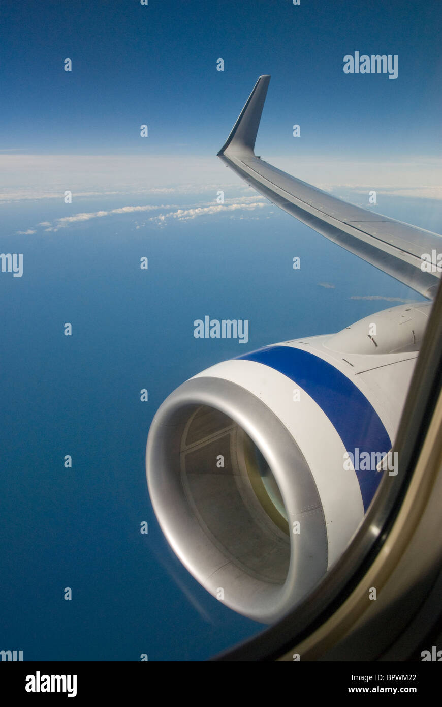 View from aeroplane window of wing and engine over Tasman Bay, South Island, New Zealand - Stock Image