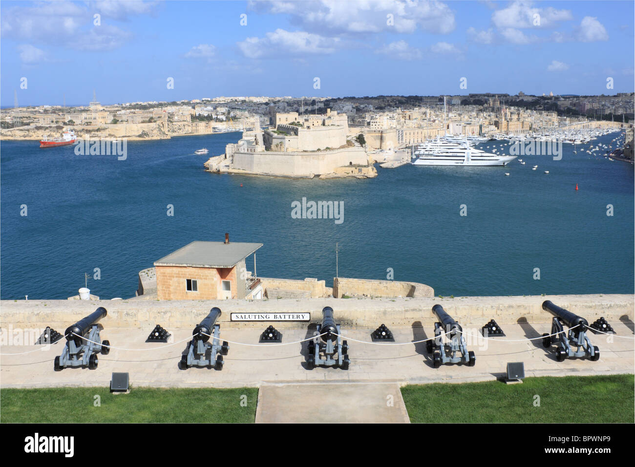 Saluting Battery, and Vittoriosa beyond, seen from Upper Barakka Gardens. Grand Harbour, Valletta, Malta, Mediterranean, - Stock Image