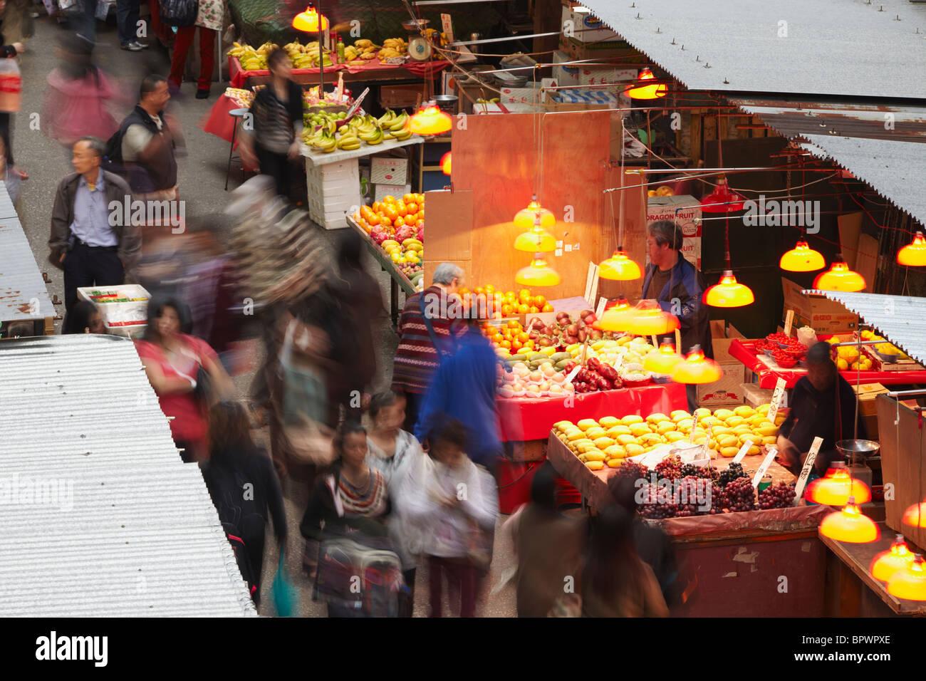 People walking along Fa Yuen Street market, Mong Kok, Kowloon, Hong Kong, China - Stock Image