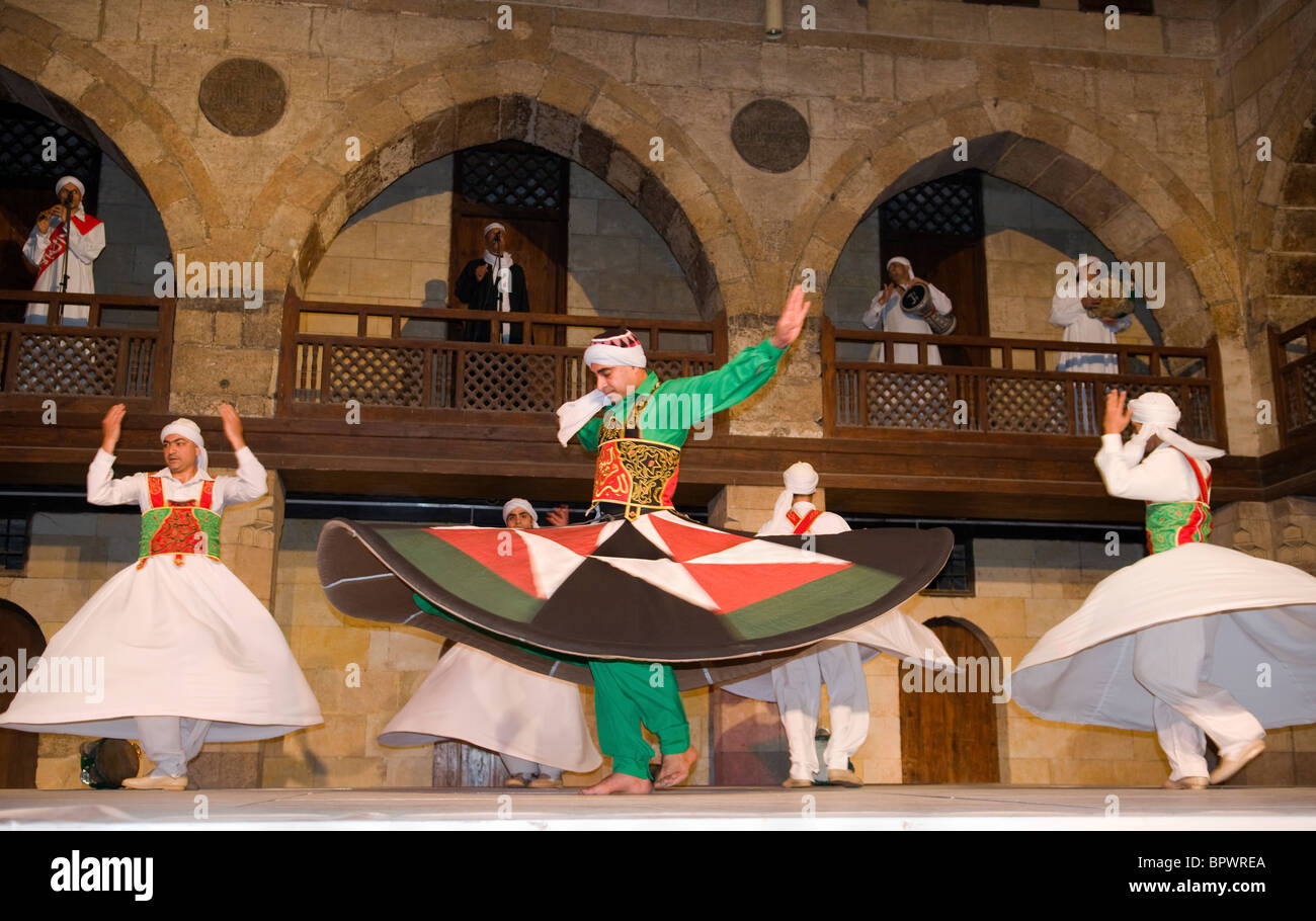 whirling dervish Sufi dancers in motion at performance in Cairo Egypt - Stock Image