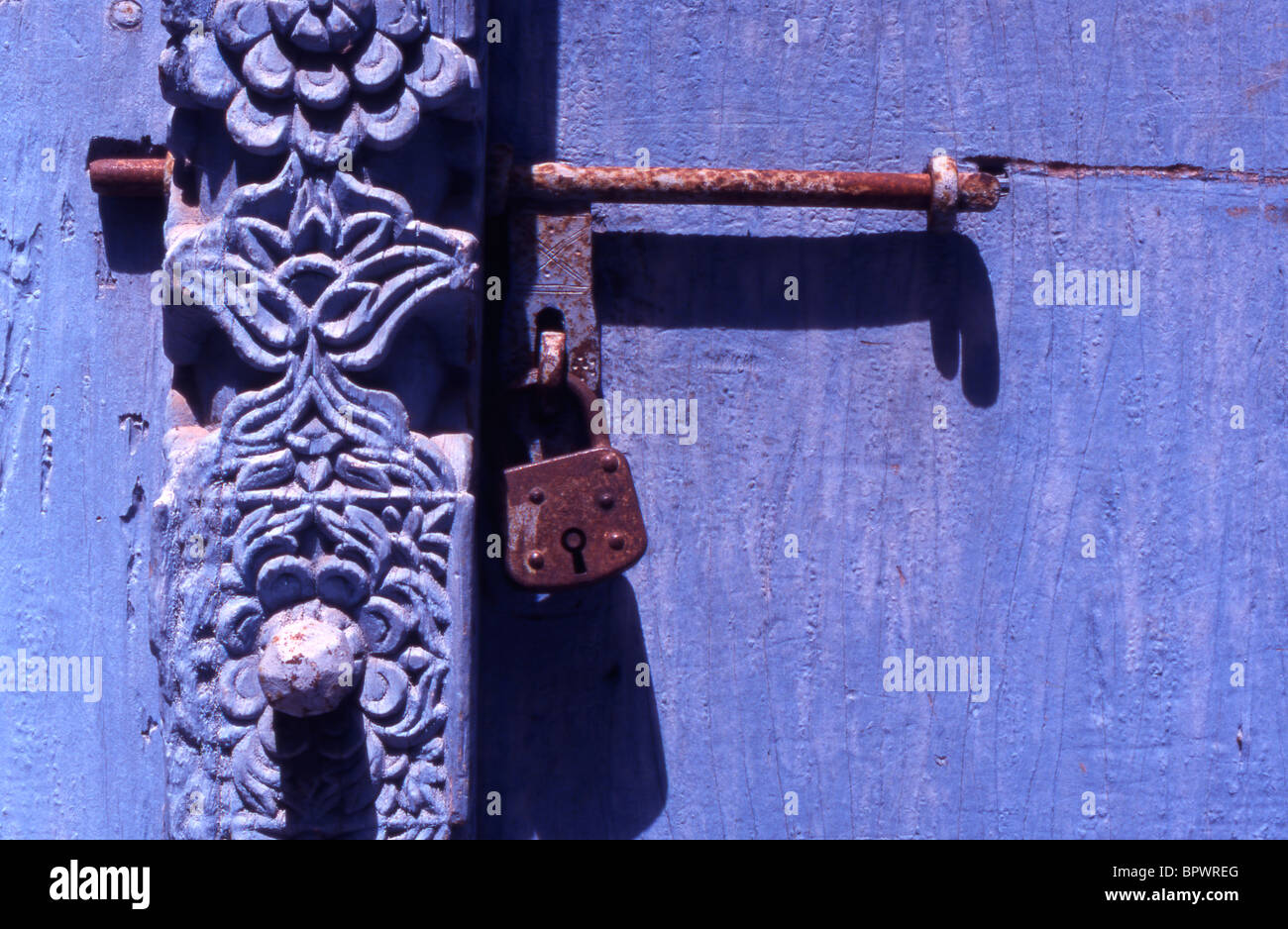 Detail of wooden engraving on a locked door in Stone Town, Zanzibar, Tanzania. Stock Photo