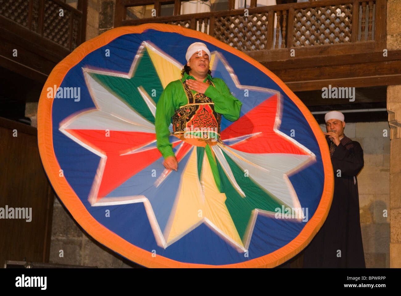 whirling dervish Sufi dancer in motion at performance in Cairo Egypt - Stock Image