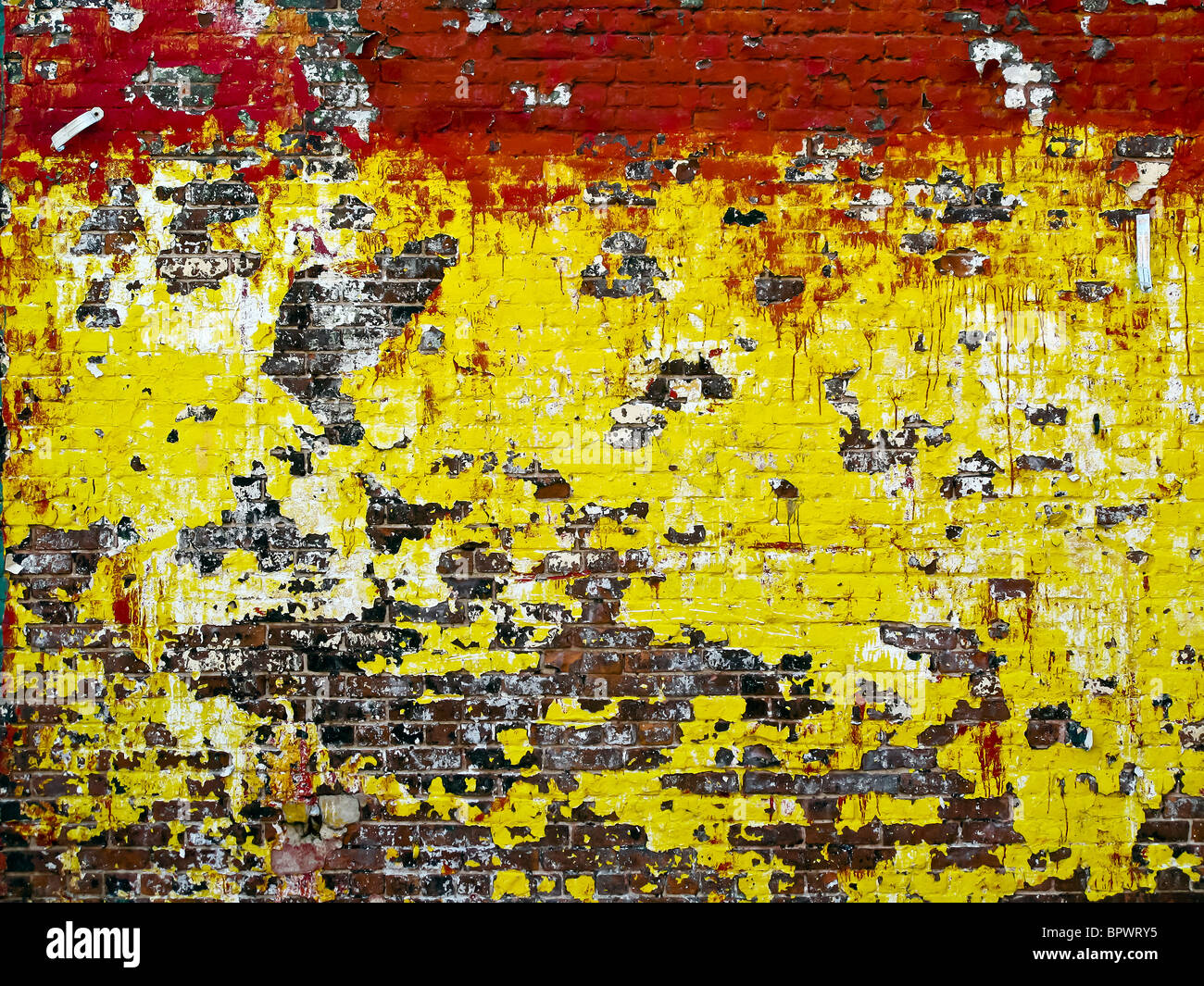 Brick wall that has been painted in New York City Stock Photo ...