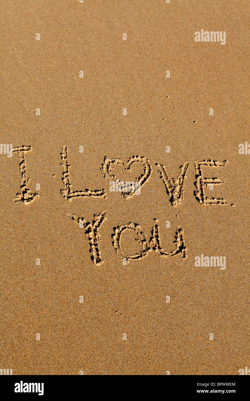 The Words I Love You Are Written On The Golden Sands Of A Beach
