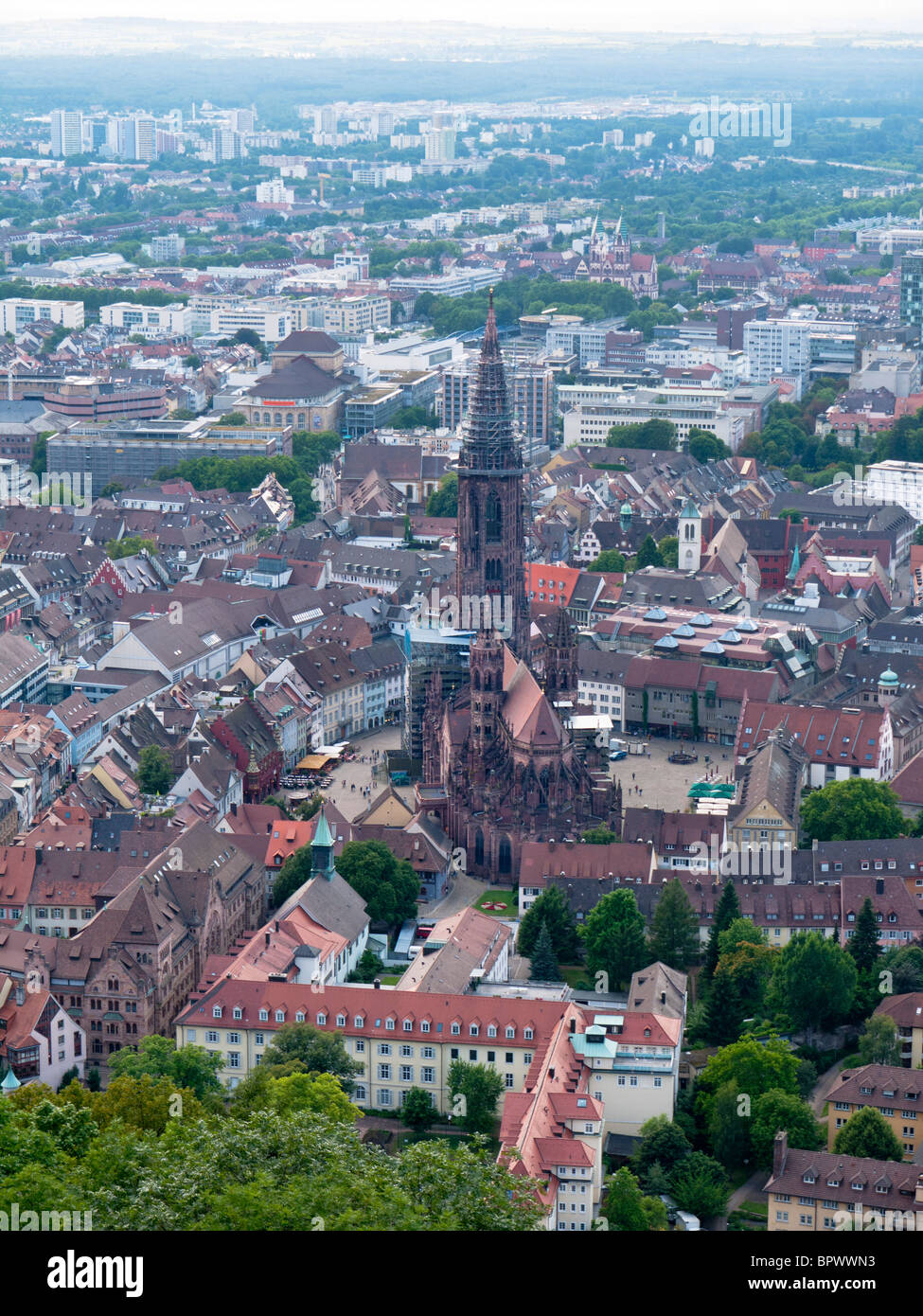 City view of Freiburg im Breisgau with the Freiburg Munster cathedral in Southern Germany - Stock Image