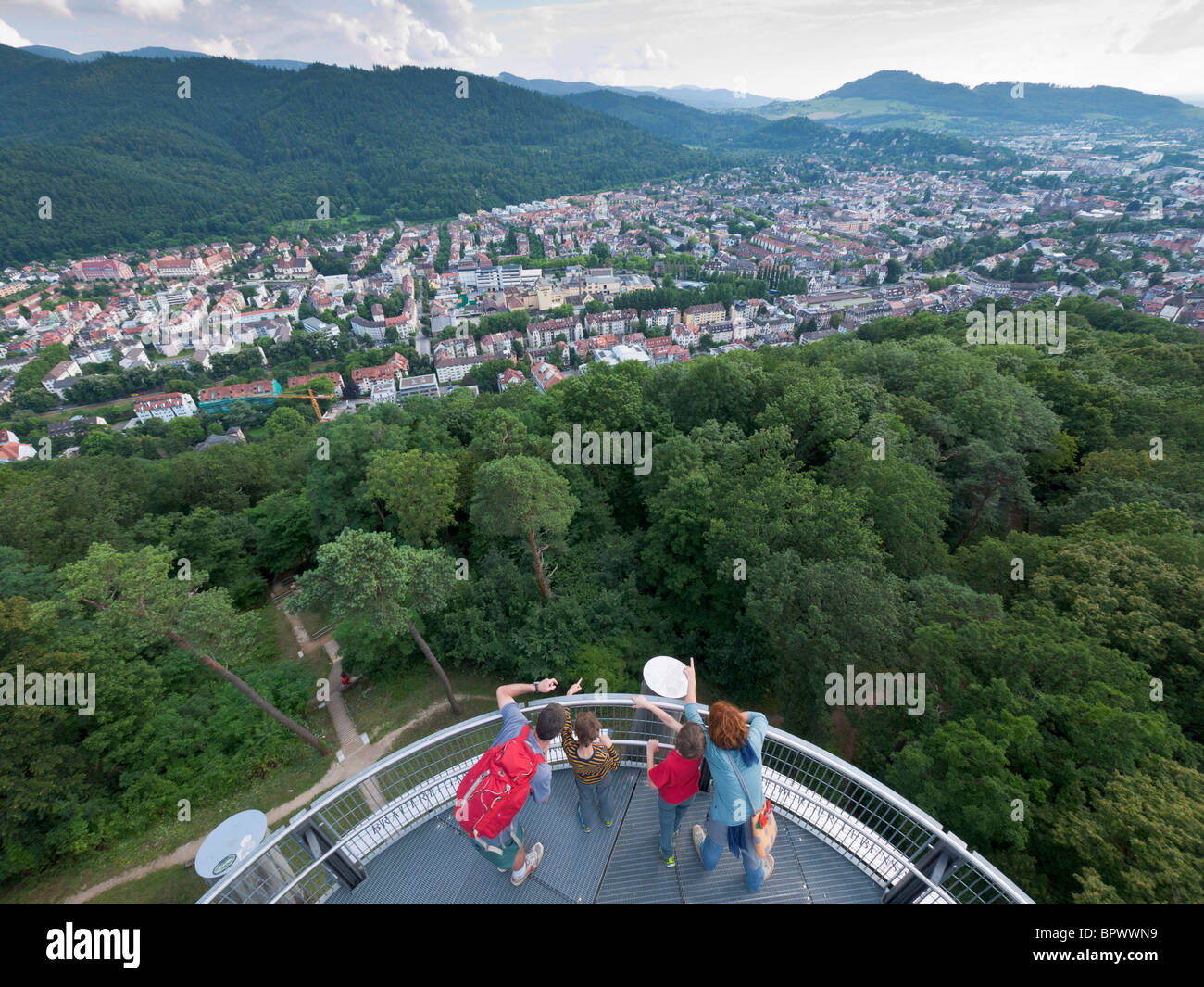 A family looks toward the Black Forest from the Schlossbergturm (castle hill tower) at Freiburg im Breisgau / Southern - Stock Image