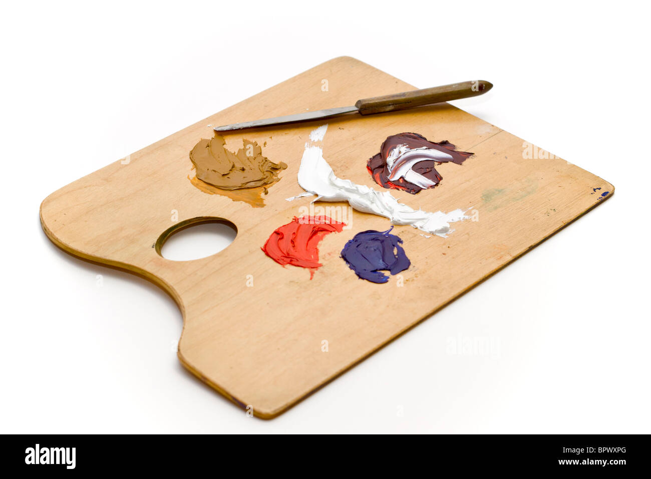 Artists palette with oil paints and palette knife on a white background - Stock Image