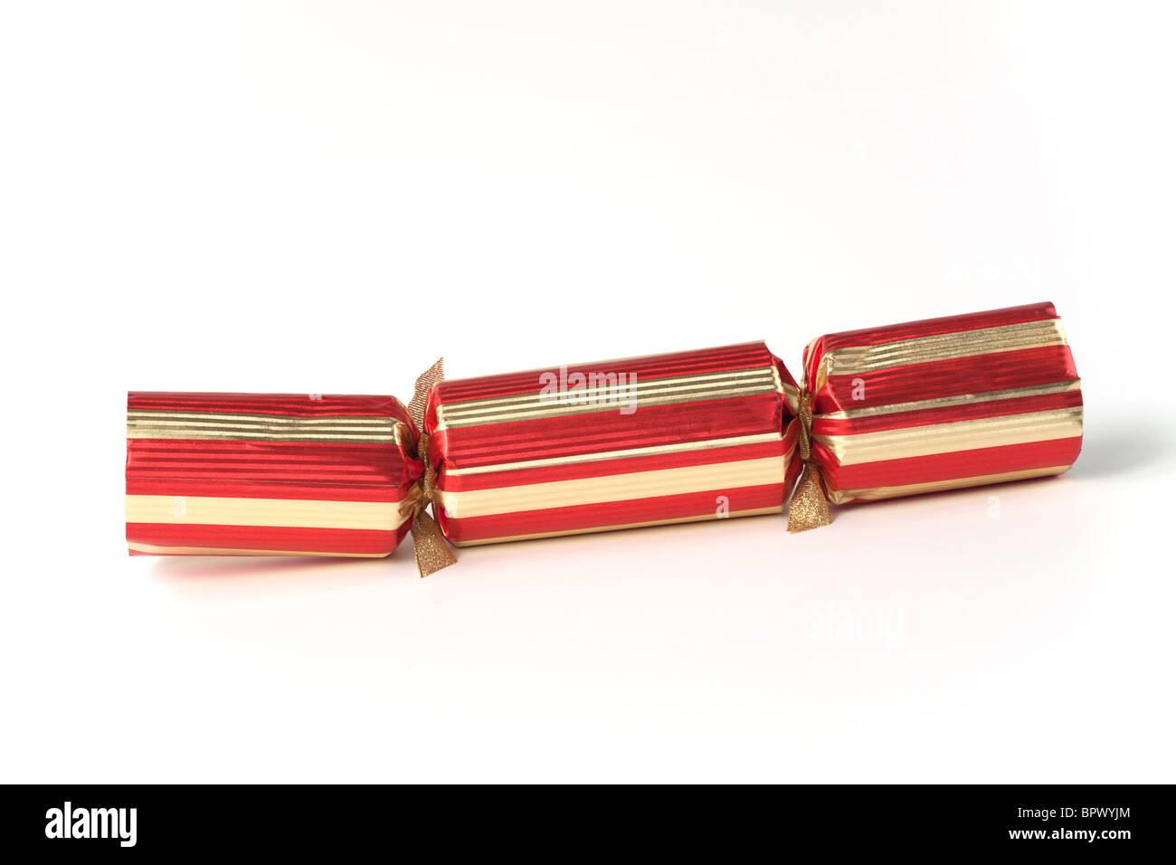 Red and gold elegant large Christmas cracker - Stock Image