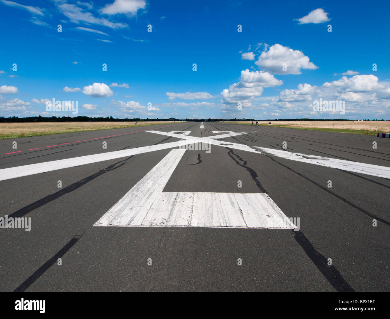 Disused runway at new city public Tempelhofer Park on site of famous former Tempelhof Airport in Berlin Germany - Stock Image