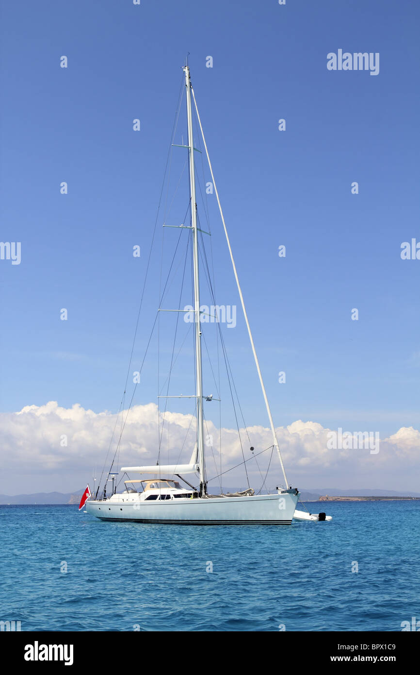 anchored sailboat Formentera turquoise Illetes Balearic islands Spain - Stock Image