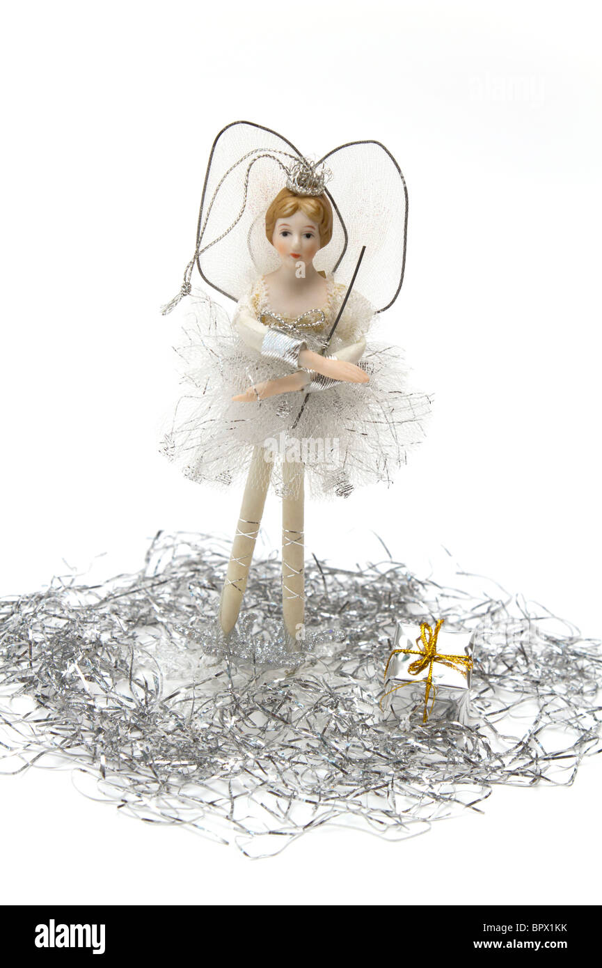 White and silver Christmas fairy with tinsel and a tiny boxed gift - Stock Image