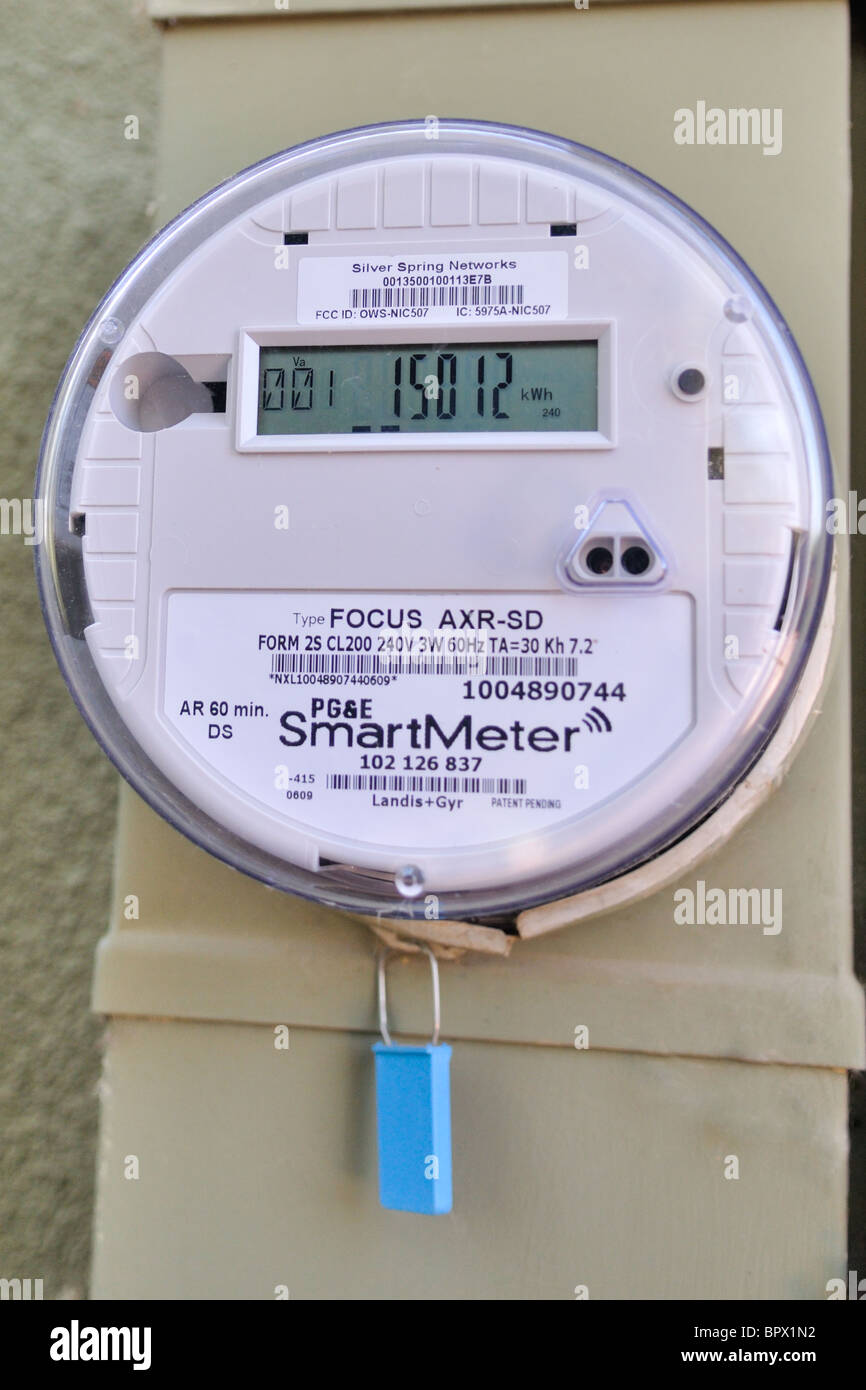 Smart meters provide meter readings electronically, eliminating the need for a human to read the power meter at Stock Photo