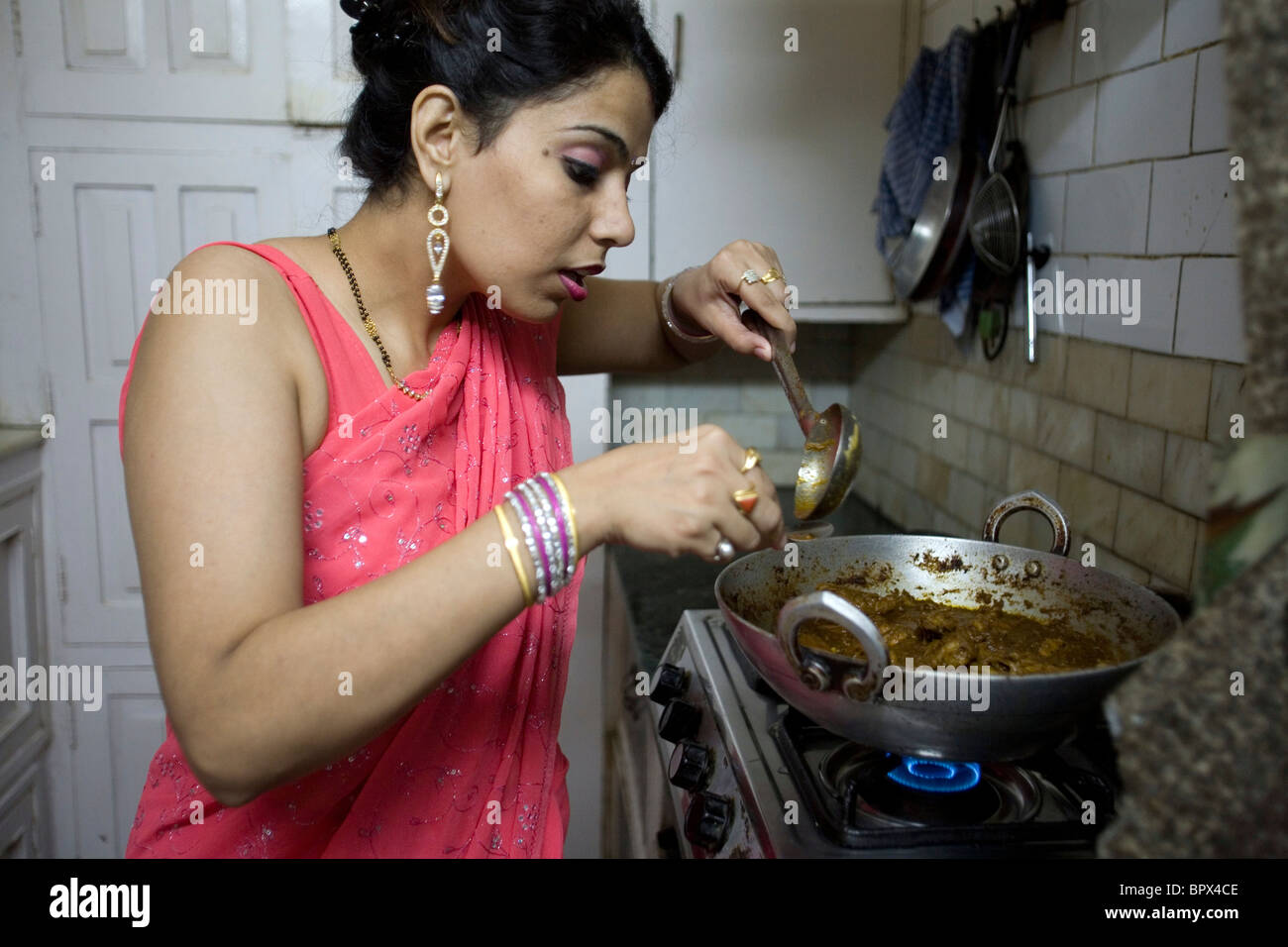 An Indian Housewife At Home In New Delhi Cooks Her Favourite Dish