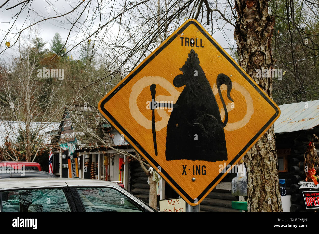 along the Great Smoky Arts and Crafts Community humorous troll crossing sign along highway Stock Photo