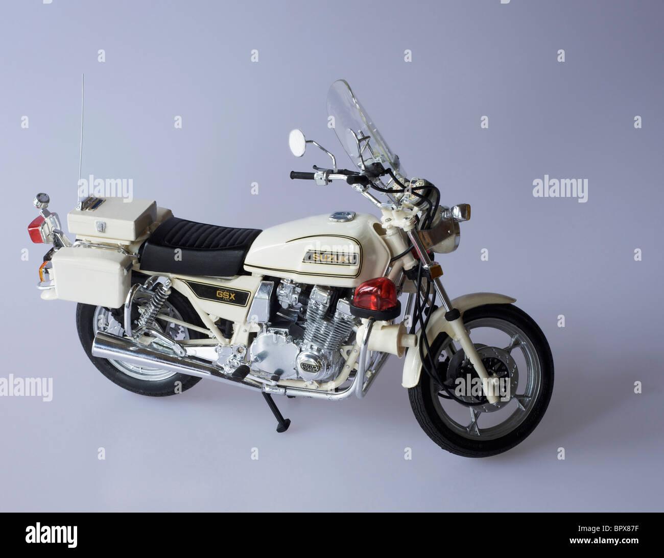 hand built  brush painted plastic construction kit by Tamiya of Suzuki 750cc Japanese police motorcycle - Stock Image