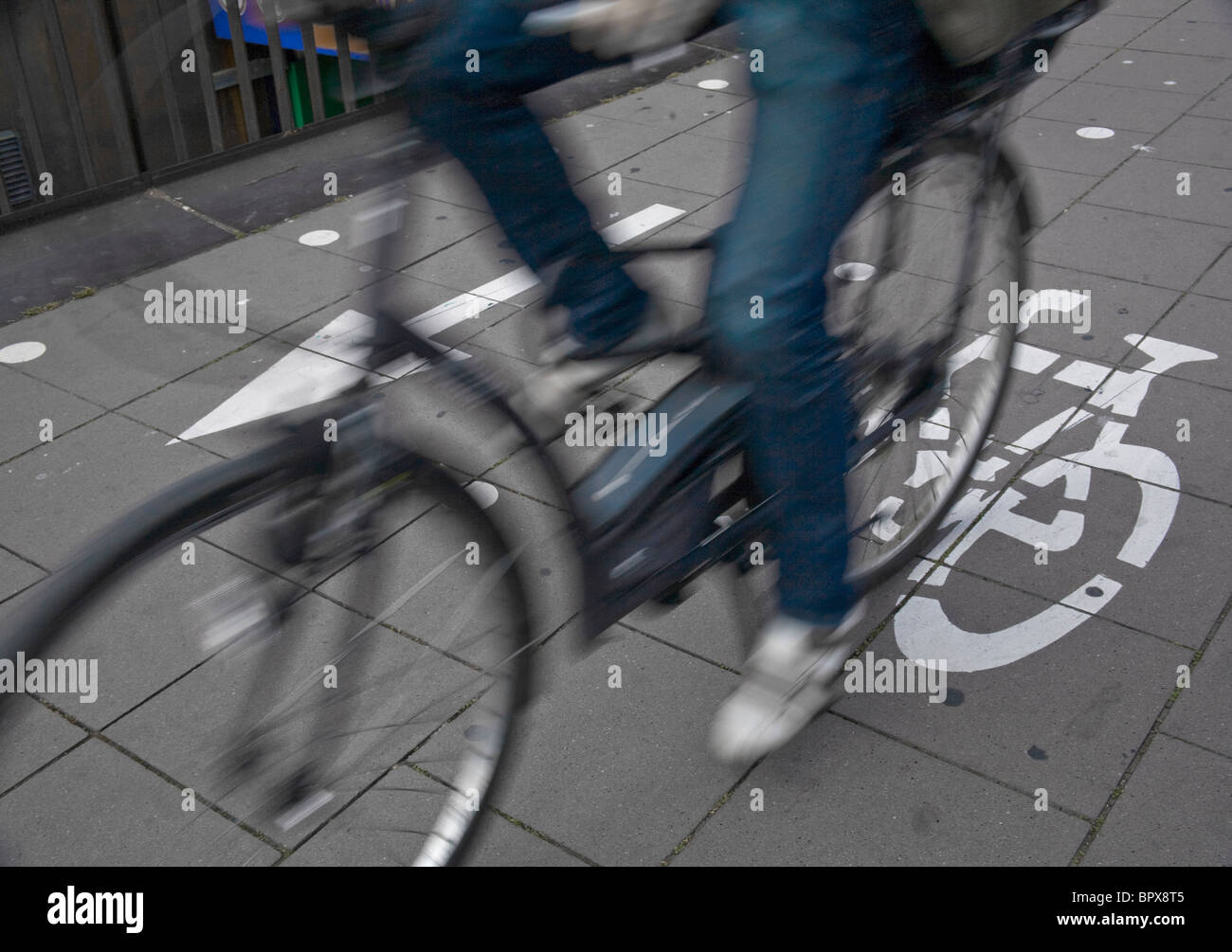 Speedy cyclist commuting on an urban cycleway. - Stock Image