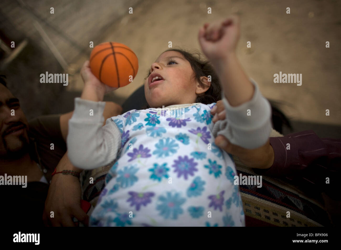 A girl who suffers infantile cerebral paralysis during her horse therapy session in Mexico City - Stock Image