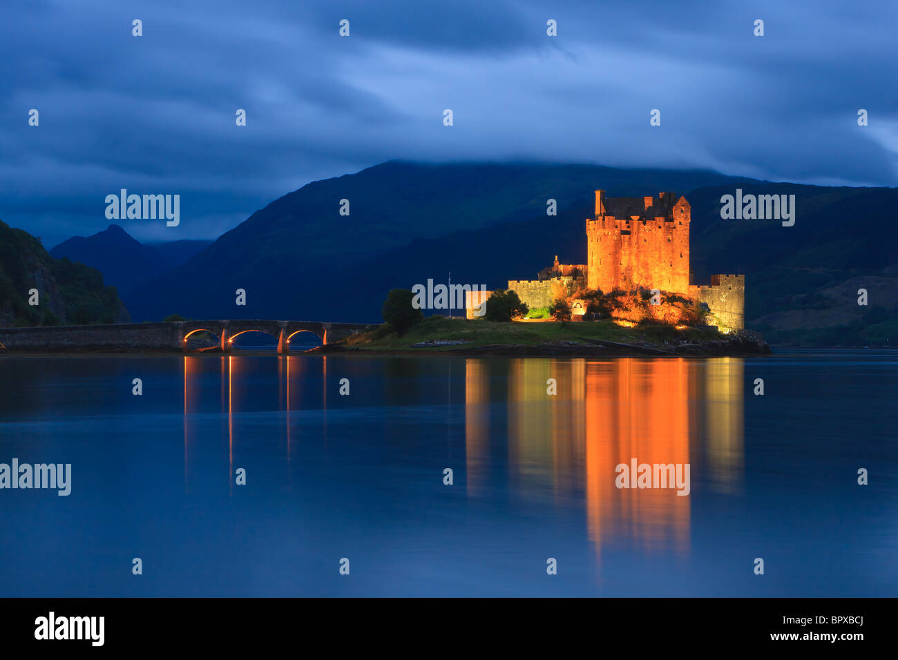 Famous Eilean Donan Castle at the blue hour after sunset, Scotland Stock Photo