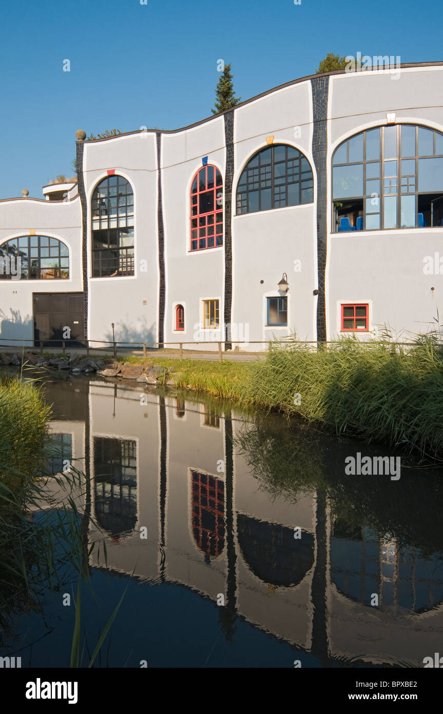 Building Reflected in Water, Bad Blumau Hot Springs Village Designed by Friedensreich Hundertwasser, Styria, Austria - Stock Image