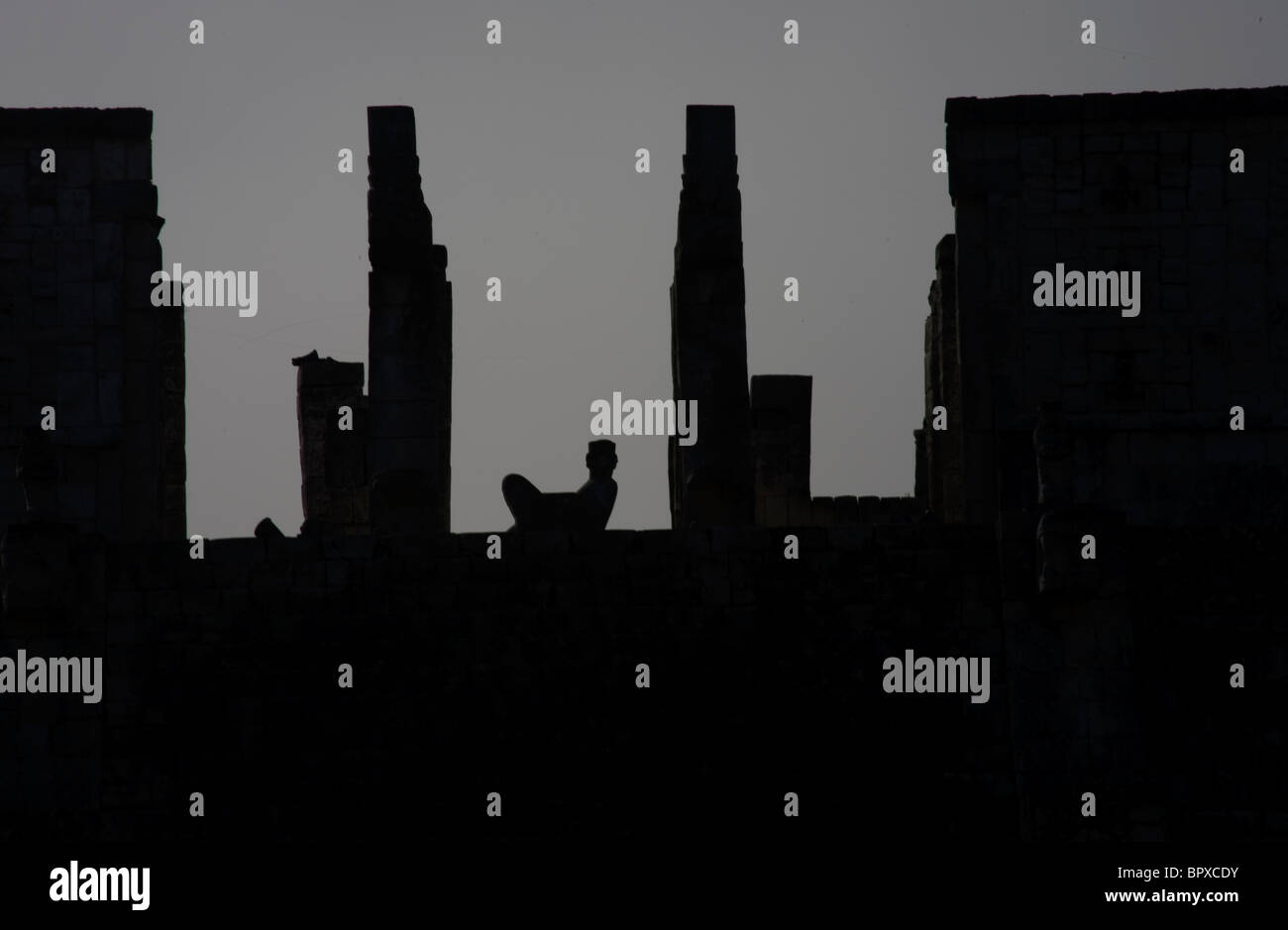 The silhouette of a Mayan temple among the ruins of Chichen Itza, Yucatan Peninsula, Mexico, July 16, 2009. - Stock Image