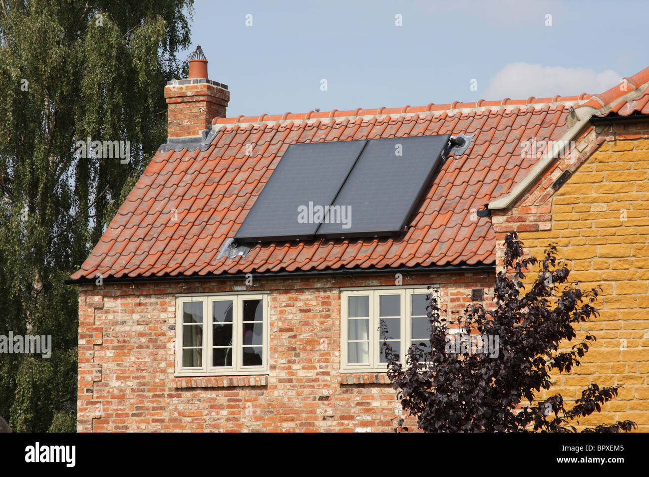 Solar panels on a house in the U.K. - Stock Image
