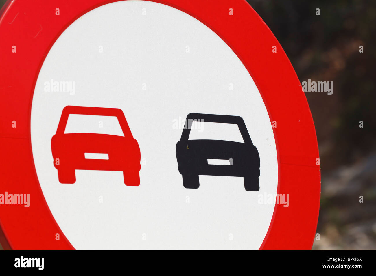 No Passing road sign on a Spanish road. - Stock Image