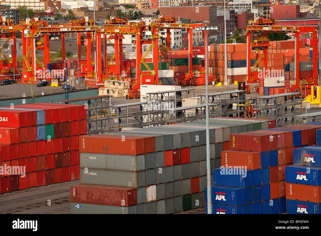 Cargo containers being off loaded in the port city of Vancouver, Canada - Stock Image