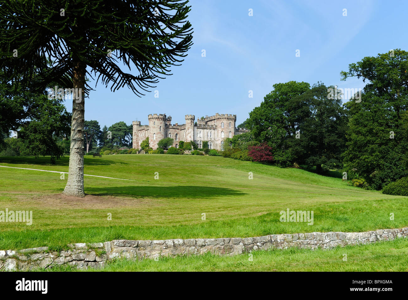 Cholmondeley Castle from the visitors field car park - Stock Image