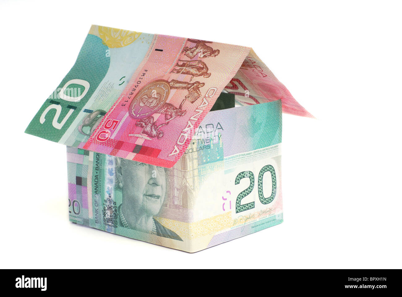 House made of Canadian money - Stock Image